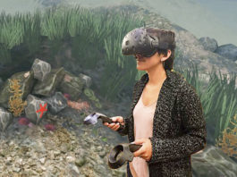 Elise Ogle, a researcher in the Virtual Human Interaction Lab, tries out the Stanford Ocean Acidification Experience, with a coral animation still in the background. (Image credit: Stanford Virtual Human Interaction Lab)